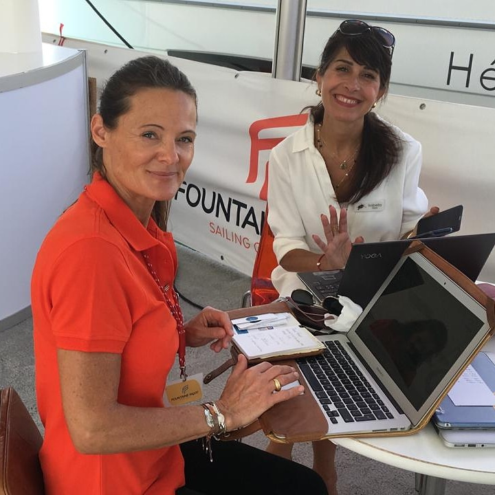 Anne-Sophie working with colleague of Dream Yacht Charter
